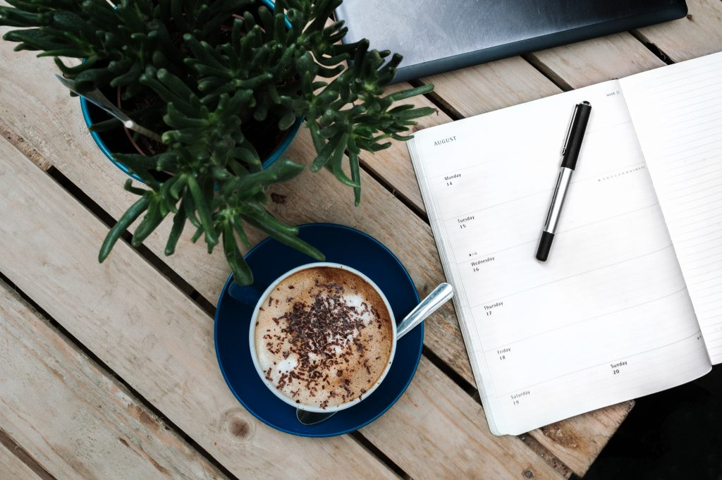 Coffee and agenda on a table